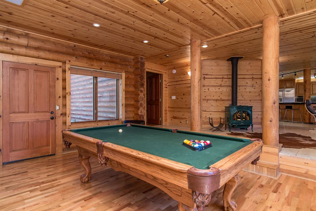 Light a fire in the wood stove and claim a spot at the pool table to show your billiards skills.