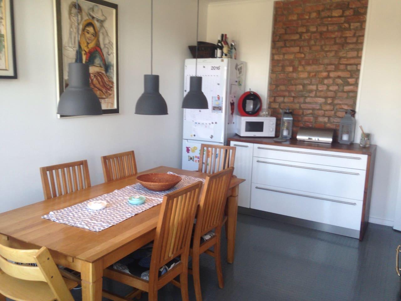 Kitchen with big dinnertable.