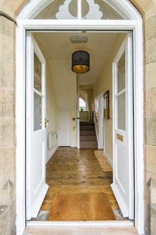 The entrance hall would once have taken you to the station ticket office and then through to the platform.  Now, it has places to hang coats, a useful cupboard for storing large bags and gives access to the living room, kitchen and bathroom.