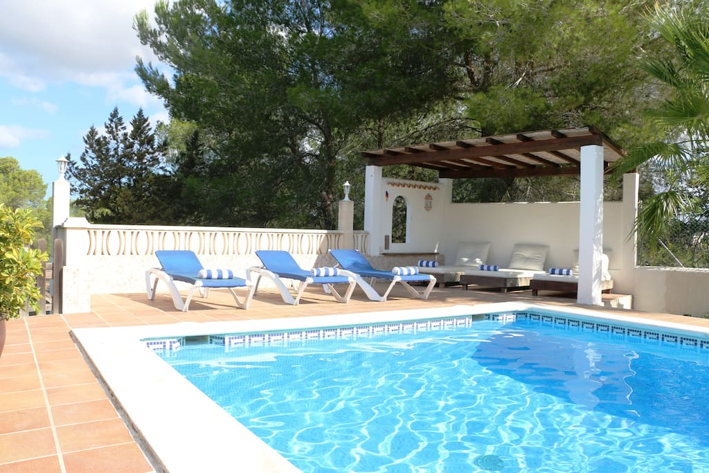 Chill out by the pool at Villa Susan - a comfy shaded sunbed area also