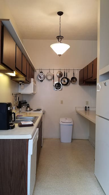 Kitchen with stove, microwave, fridge and everything you need to make delicious meals.