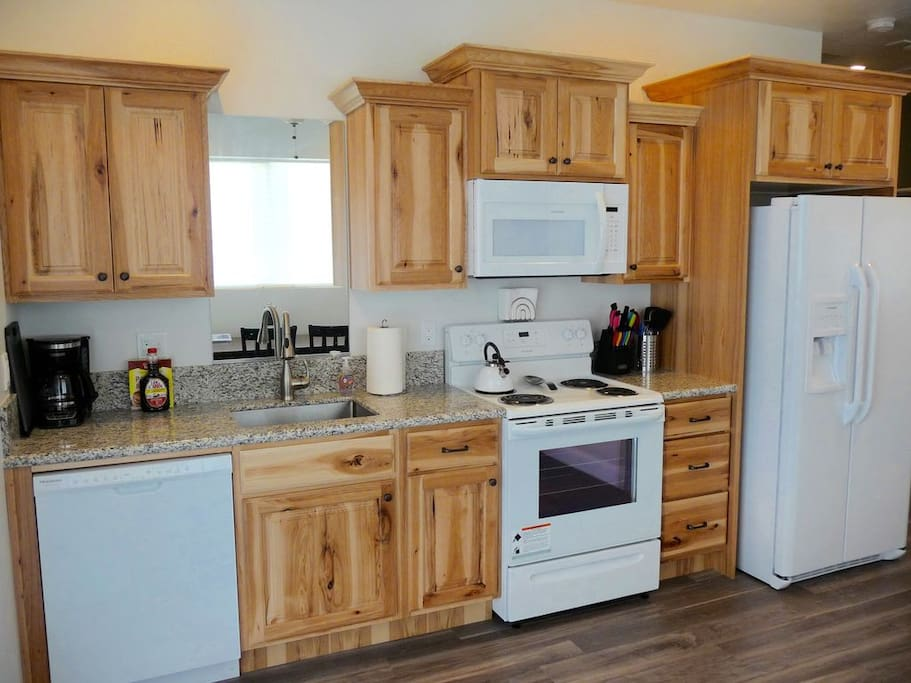 The kitchen has full size appliances and makes a great place for making meals