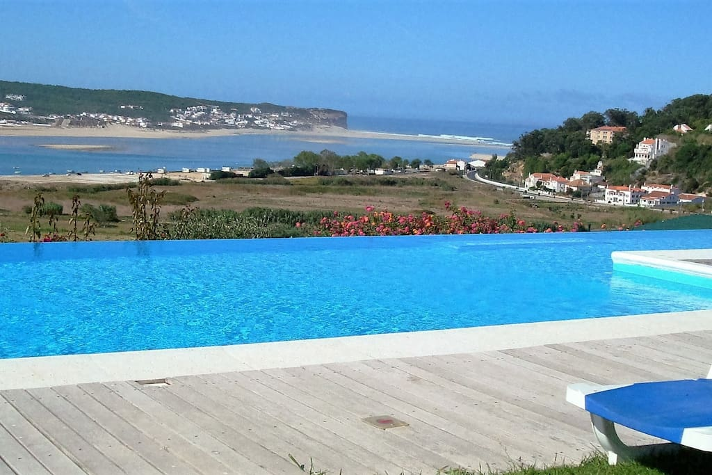 Large heated pool measuring 16 x 5 meters, with kids pool area and solid transparent fence protrection