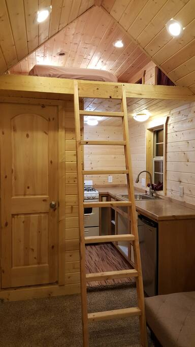 View of kitchen and ladder to loft.