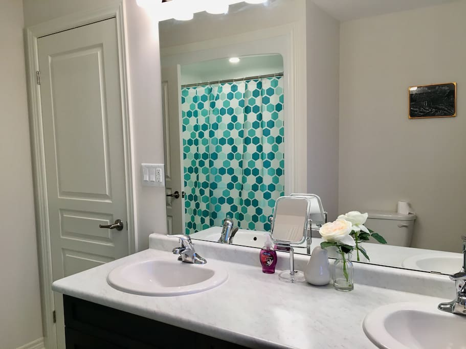 spacious attached washroom with double sink