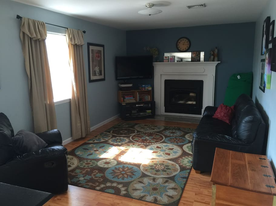 Family room with large screen TV and gas fireplace