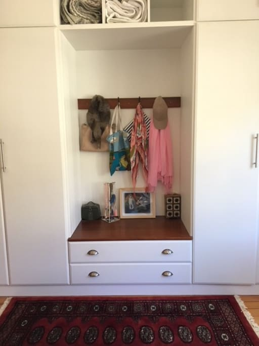 Cupboard space available in a spacious bedroom - hanging and storage space.
