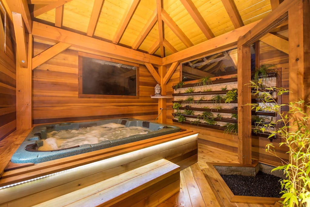 This is a private hot tub area. Inside this area is completely private with four walls. There is a Coldwater rain shower located to the right for ultimate fun between hot tub and cold shower