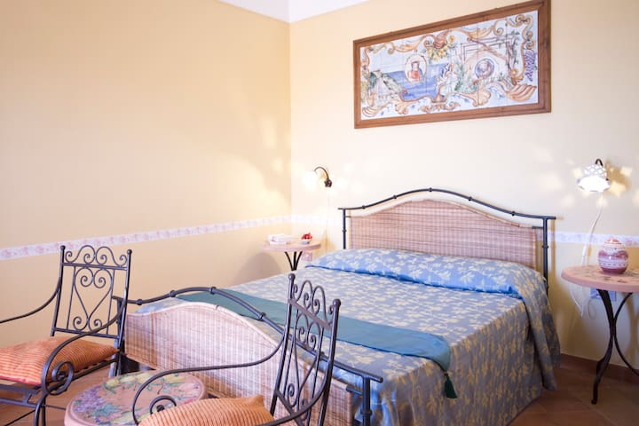 Double bed. Ceramic panel whit historical traditions and local view handmade by us.