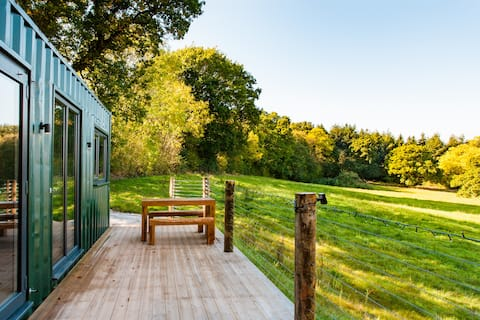 Converted Shipping Container Nestled in an Idyllic Meadow