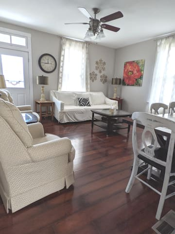 Family room, has dining table seats 6, 1 couch, 2 swivel chairs, ceiling fan,  flat screen smart TV with Roku, WiFi, board games, cards, books, toys.