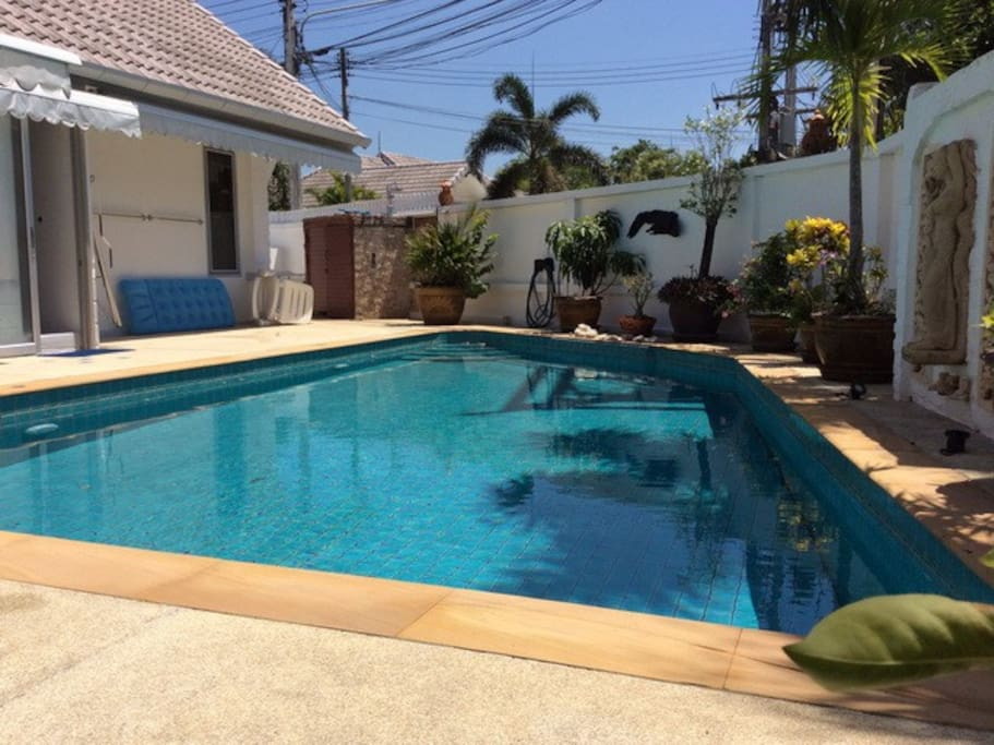 private swimming pool with lounger and 4 seats out door table