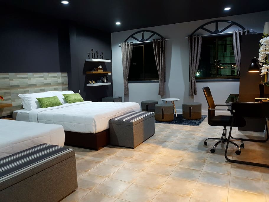 Very spacious Grand Suite room with its lounge area, views over looking Patong city, with SMART LED T.V, cable access, mini fridge with free water and comfortable work desk/chair & more greatness.