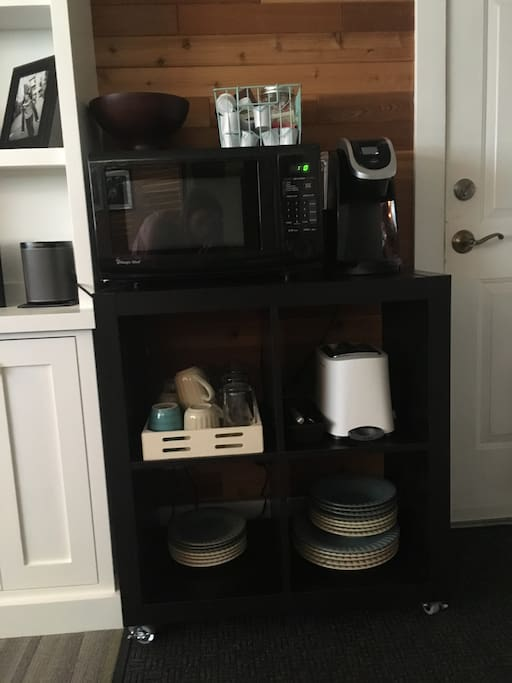 Coffee maker, microwave, toaster and dishes provided. Table and chairs also available in closet