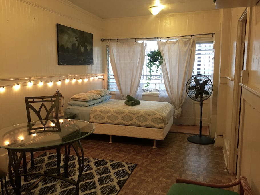 The Living Room features a full size bed and Bistro dining set.