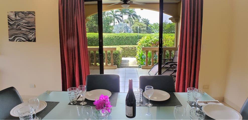 Dining area with view to terrace and access to garden