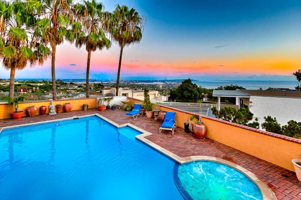 View from balcony overlooking pool and ocean views.