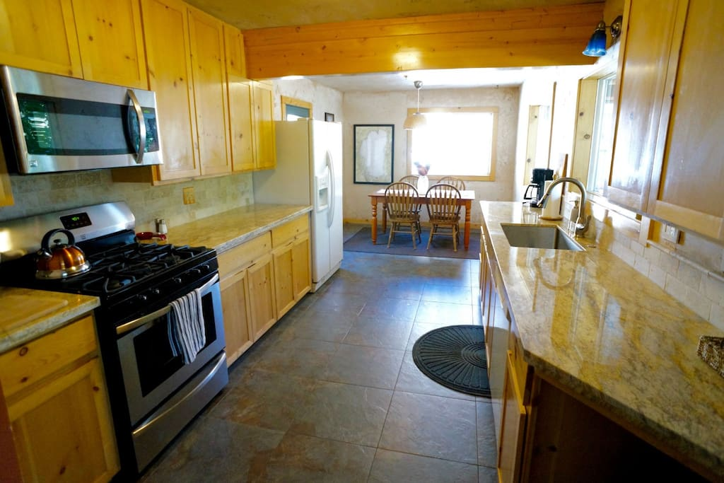 Newly renovated kitchen with full appliances.