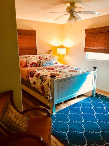 Queen bed with tv