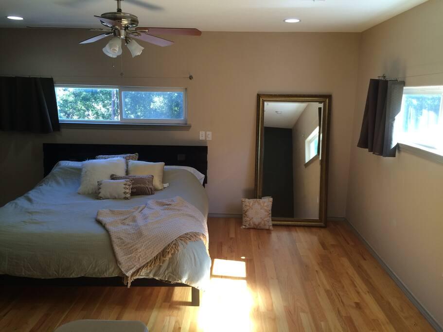 Comfortable King Bed in Upstairs Wood Floor Master Bedroom