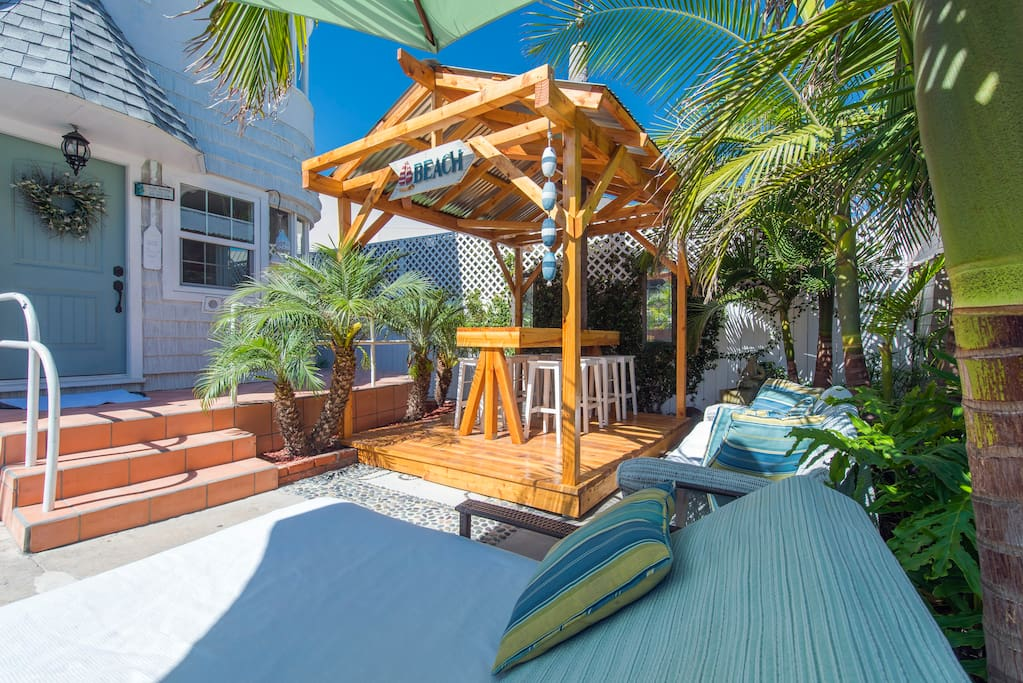 Beautiful Patio with Lounges and Tiki Bar.