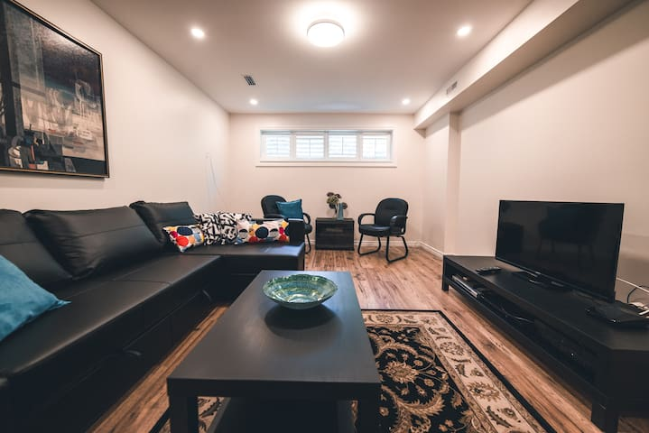 A huge living room area well-appointed with a   comfortable  Chesterfield, chairs television, Internet, and even a piano for those who can play. The Chesterfield pulls out in the evening to make a queen-size bed that easily sleeps two.