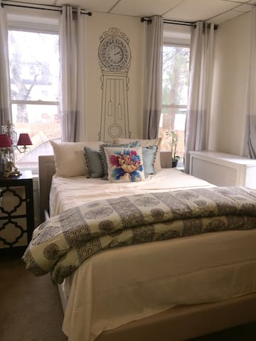 Beautiful bedroom with lots of natural light, Comfortable queen sized bed.