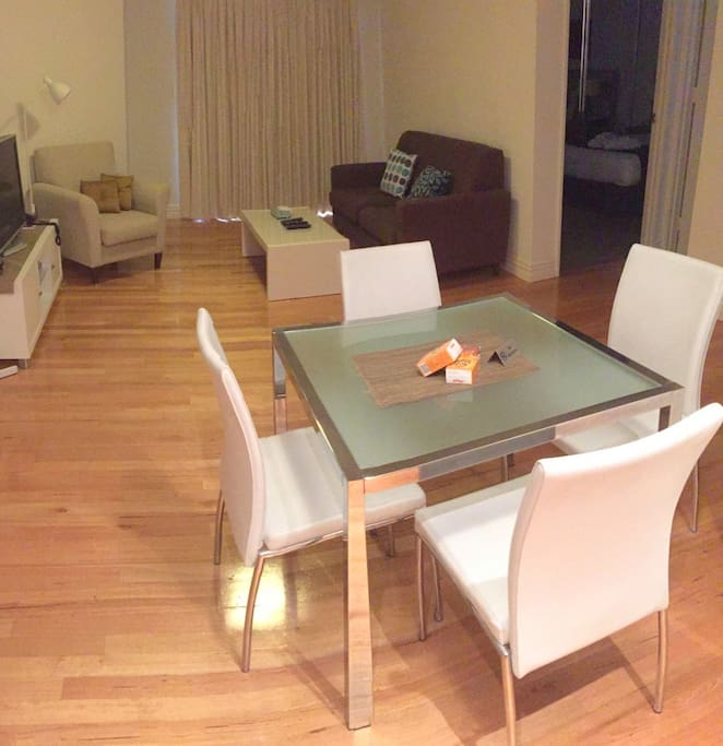 Table setting is a good size and flows to the kitchen on the left and the balcony at the rear. There is good light and airflow. Airconditioned - heating in winter and cooling in summer