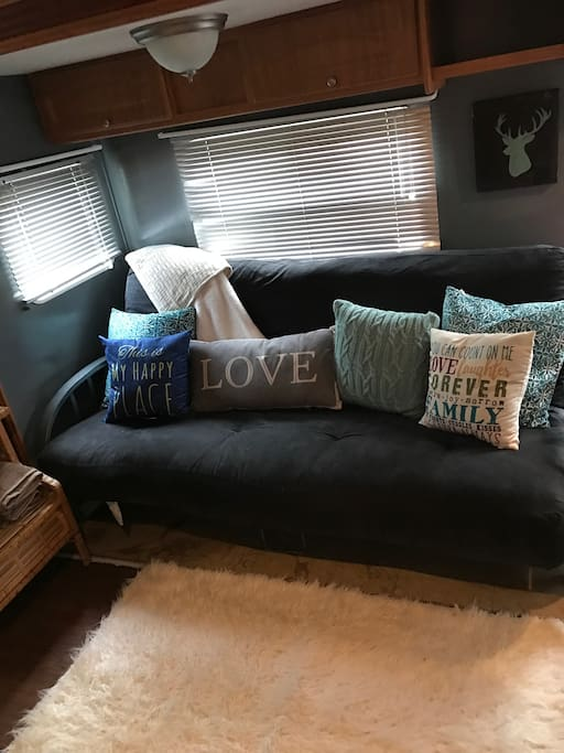 Living area with futon for extra sleepers.