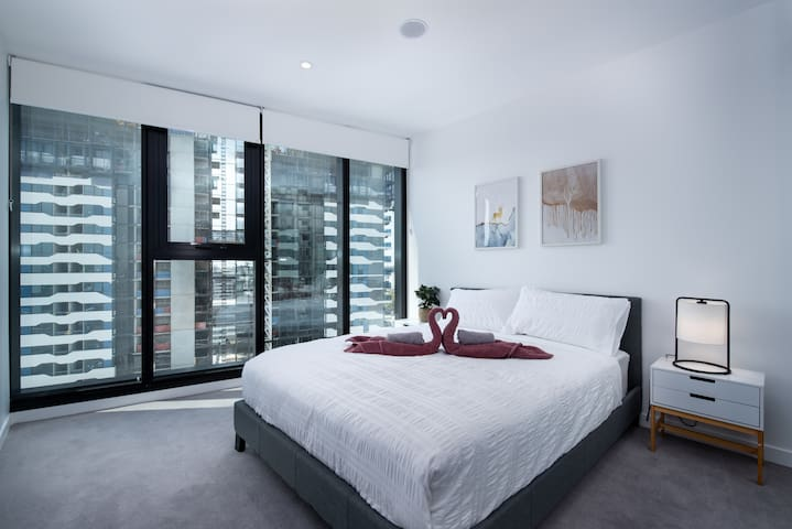 Extra-large 2nd bedroom featuring ultra comfy queen bed, air-conditioning and large wardrobes.