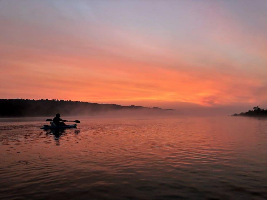 Go kayaking at sunrise & catch the mystic river fog