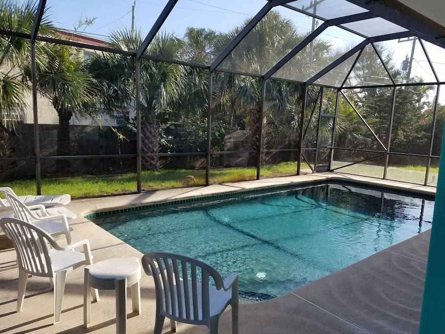 "Screened pool. Across the road from the beach. Watch ocean sunrises from the balcony, bedroom, the dining room. 100 MB WiFi, Netflix, SlingTV. One min. walk to a fun Mex. restaurant and an ice cream shop. You'll love it here at ""The Eagle's Nest!"" :)"