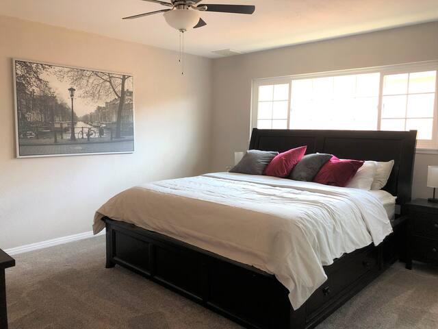 Master Bedroom - bedside lamps with several USB and Qi wireless charging capability, ceiling fan, hangers in closet
