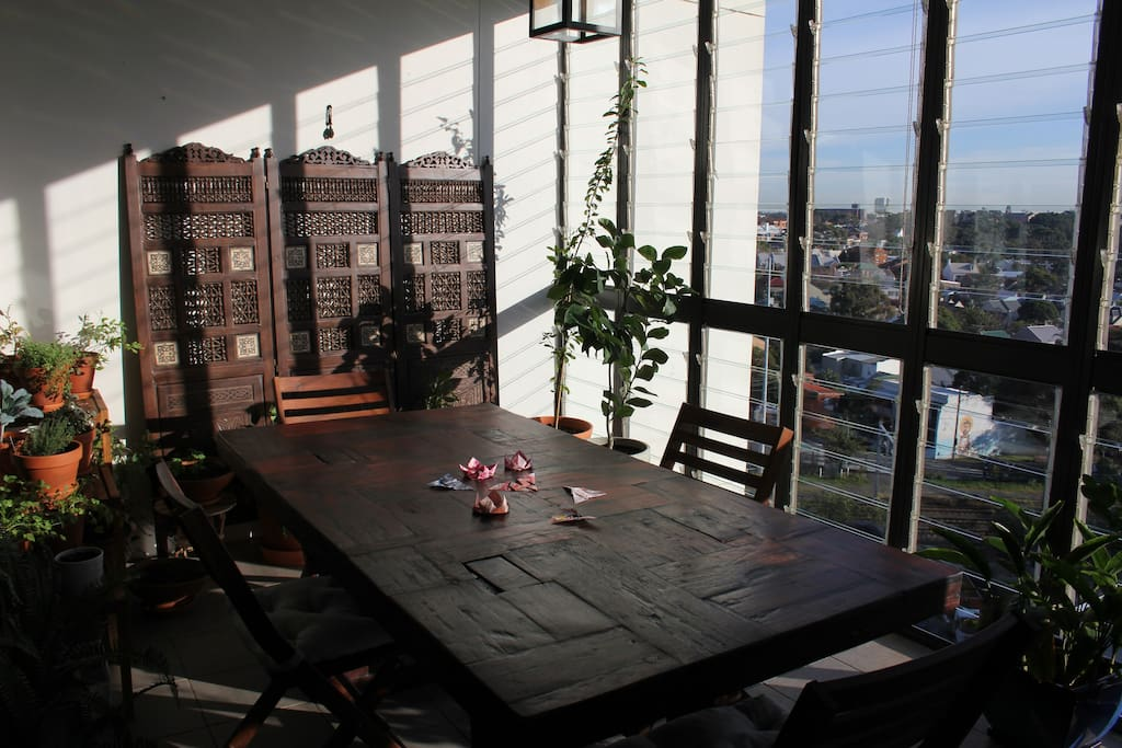 Our sunroom/dining room enjoys light and lovely views throughout the day