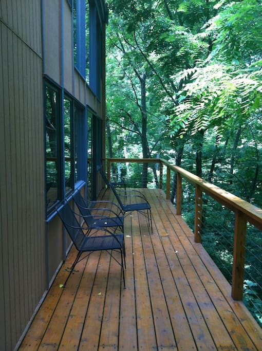 Bedroom has access to living room and deck