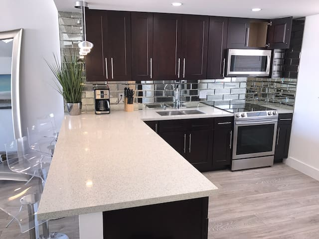 Amazing updated kitchen fully renovated with new Samsung stove and chef microwave appliances