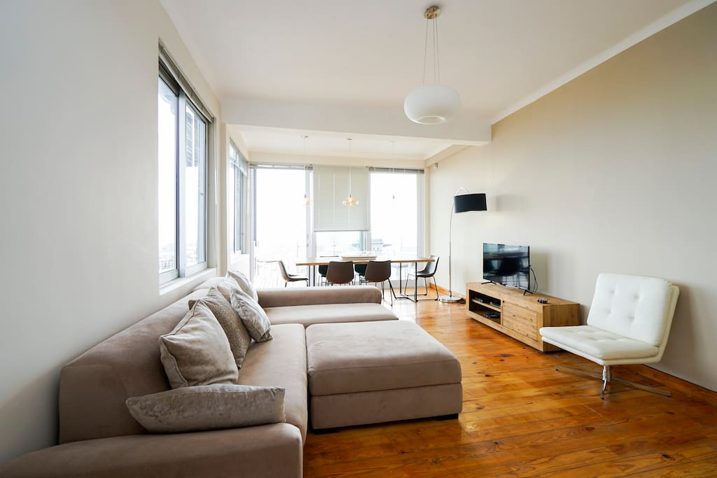 Open plan living area - lounge and dining area, leading to balcony with great views