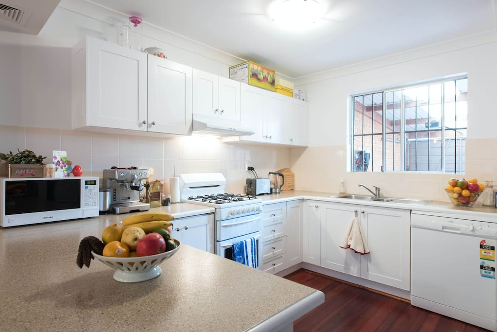 Generous gas kitchen with dishwasher, breakfast bar and internal laundry