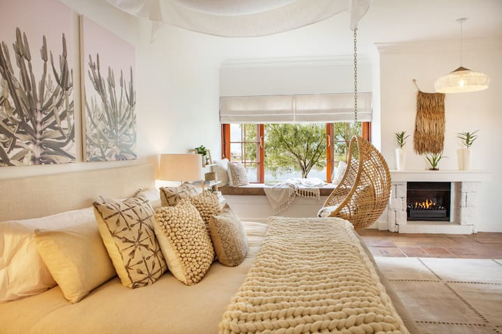Private, luxury studio with a private patio overlooking the garden with views of the Simonsberg mountain range. Kitchenette, full bathroom, and bedroom with king bed available. Enjoy flipping through the channels on the flat-screen TV with Netflix