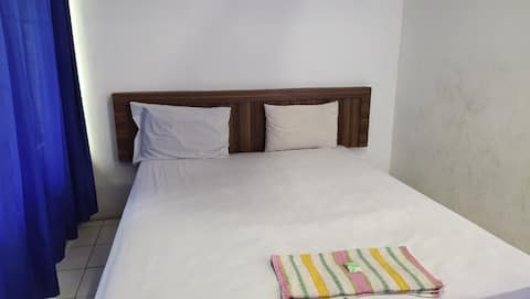 Affordable Std Fan @ De' Premium Hotel Musi Raya