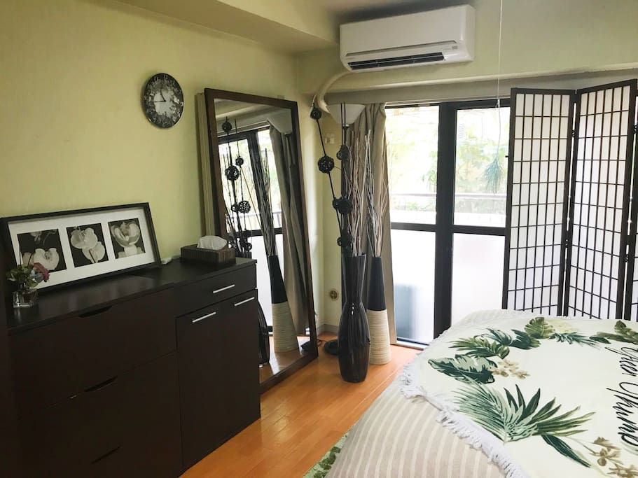 The bedroom overlooks a balcony. Great to a fresh breath of air! There is also tons of storage space.