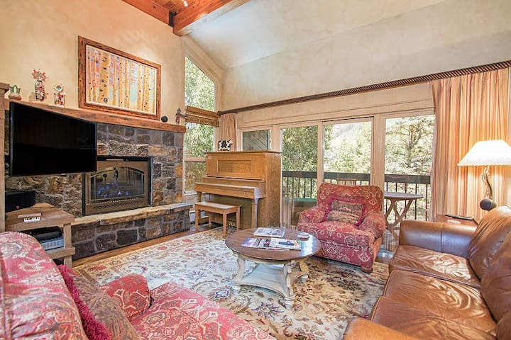 Cozy living area with elegant mountain decor, access to deck