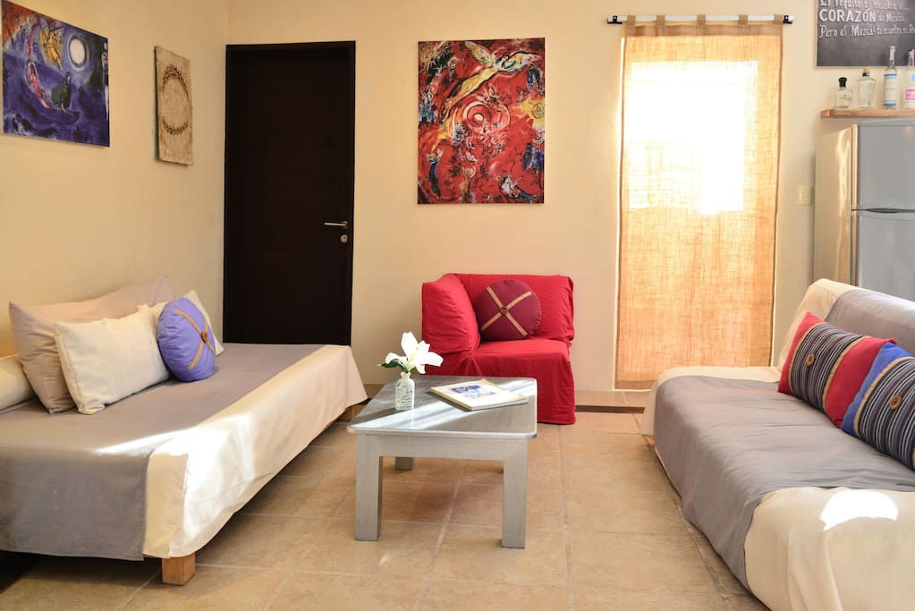 Imagine yourself in this living area, with a fold out sofa futon and twin bed for extra guests, having great conversations about everything you can do in Tulum with our personalized recommendations you can experience with your family or group of friends!