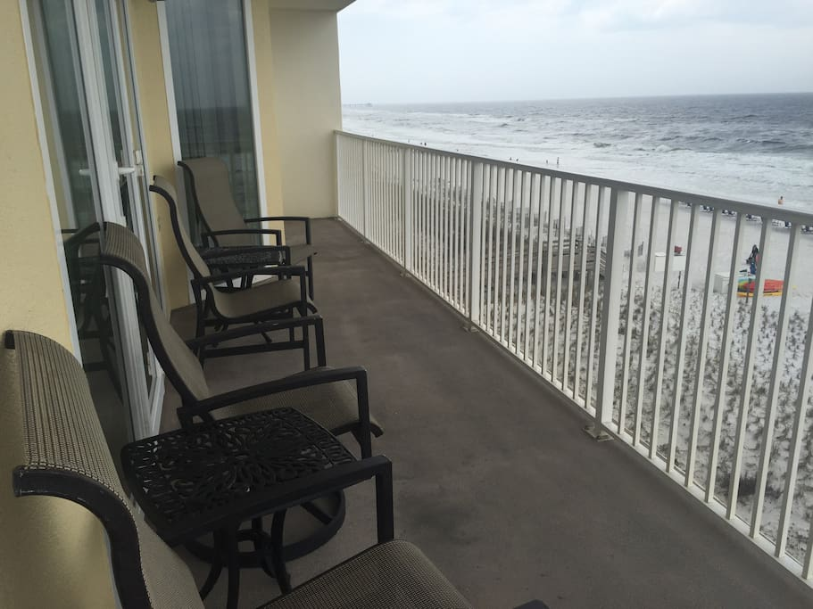 Balcony chairs and side tables.  View looking east.