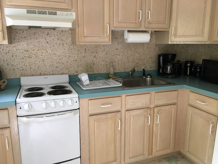 Fully equipped kitchen with full sized fridge