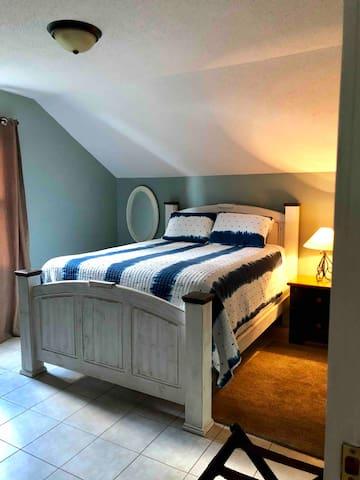 Upstairs bedroom with queen bed .