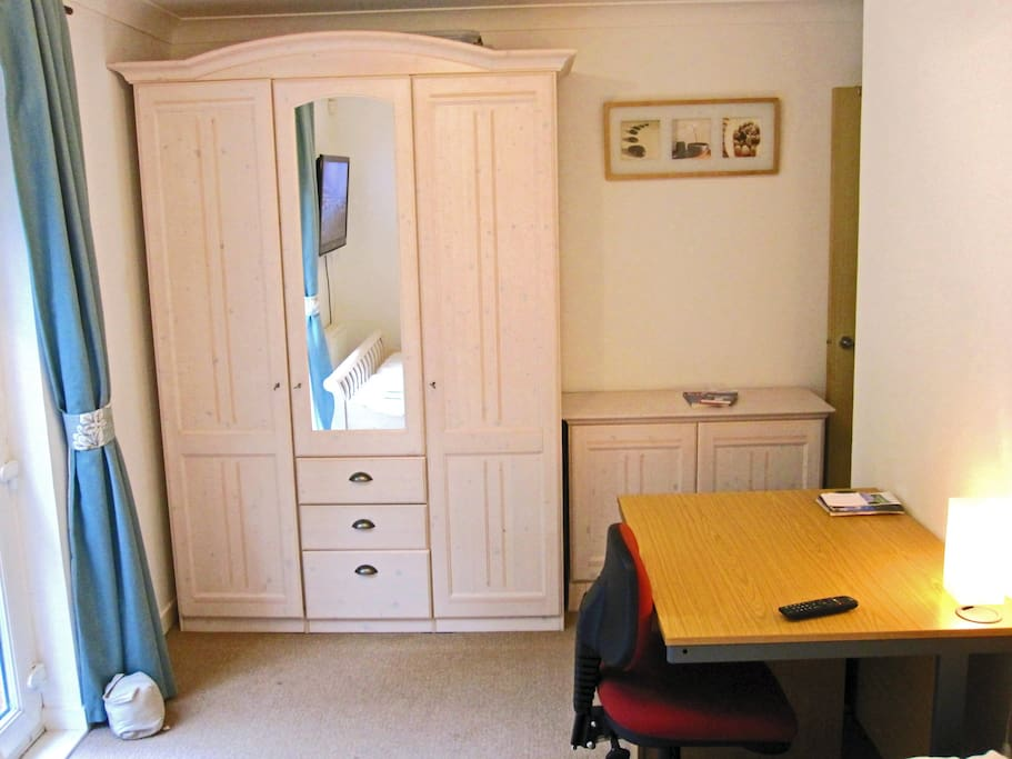 Your bedroom with a desk & wardrobe