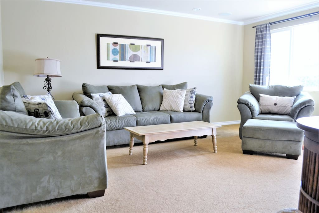 Welcoming family room with an upgraded queen sleeper sofa and cable tv.