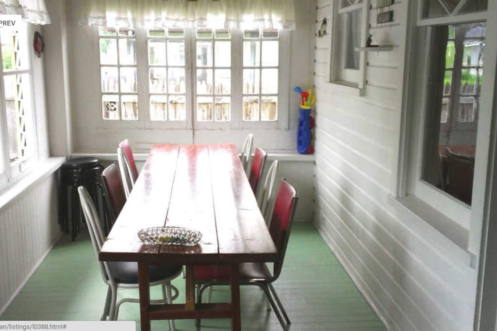 Entrance porch dining table...sits 8 comfortably