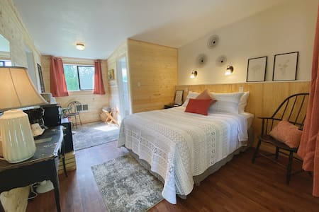 Elwha Valley room with queen-sized, sitting area, coffee maker, minifridge, microwave, and full bathroom. Adjoins to the room next door (must be booked separately and as availability permits).